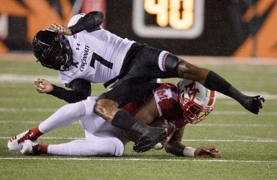 Cincinnati Bearcats cornerback Coby Bryant (7) tackles Miami (Oh) Redhawks running back Alonzo Smith (26) during the NCAA football game between Miami (Oh) Redhawks and Cincinnati Bearcats on Saturday, Sept. 8, 2018, in Downtown Cincinnati.
