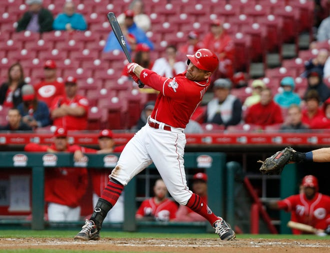 Sep 9, 2018; Cincinnati, OH, USA; Cincinnati Reds first baseman Joey Votto (19) hits a three-run home run against the San Diego Padres during the fifth inning at Great American Ball Park. Mandatory Credit: David Kohl-USA TODAY Sports