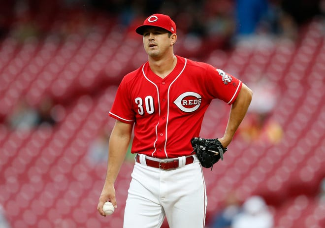 Cincinnati Reds starting pitcher Tyler Mahle (30) reacts after giving up a two-run home run to San Diego Padres' Austin Hedges during the third inning of a baseball game, Sunday, Sept. 9, 2018, in Cincinnati.