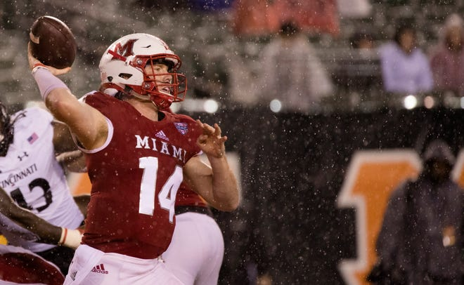 Miami (Oh) Redhawks quarterback Gus Ragland (14) throws a pass during the NCAA football game between Miami (Oh) Redhawks and Cincinnati Bearcats on Saturday, Sept. 8, 2018, in Downtown Cincinnati.