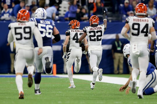 Cincinnati Bengals safety Clayton Fejedelem (42) returns a fumble recovery for a touchdown in the fourth quarter during the Week 1 NFL game between the Cincinnati Bengals and the Indianapolis Colts, Sunday, Sept. 9, 2018, at Lucas Oil Stadium in Indianapolis. Cincinnati won 34-23.