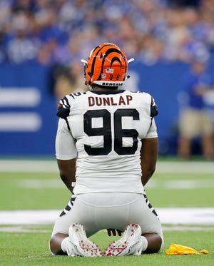 Cincinnati Bengals defensive end Carlos Dunlap (96) reacts after being flagged for roughing the passer in the third quarter of the NFL Week One game between the Indianapolis Colts and the Cincinnati Bengals at Lucas Oil Stadium in Indianapolis on Sunday, Sept. 9, 2018. The Bengals begin the season with a 34-23 win in Indianapolis.