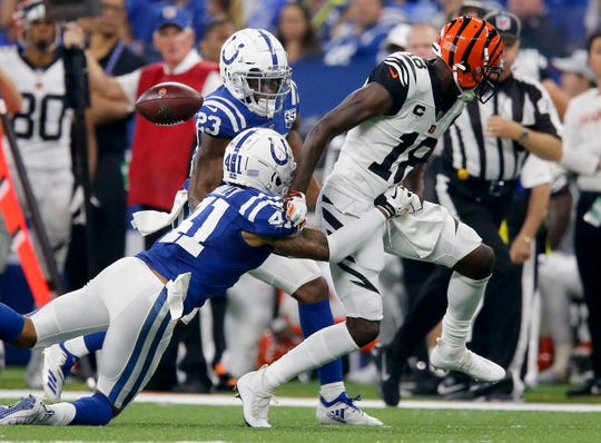 Cincinnati Bengals wide receiver A.J. Green (18) loses the ball for a fumble after catch in the first quarter of the NFL Week One game between the Indianapolis Colts and the Cincinnati Bengals at Lucas Oil Stadium in Indianapolis on Sunday, Sept. 9, 2018. The Colts led 16-10 at halftime.