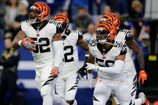 Cincinnati Bengals linebacker Preston Brown (52) reacts after intercepting a pass in the first quarter during the Week 1 NFL game between the Cincinnati Bengals and the Indianapolis Colts, Sunday, Sept. 9, 2018, at Lucas Oil Stadium in Indianapolis.