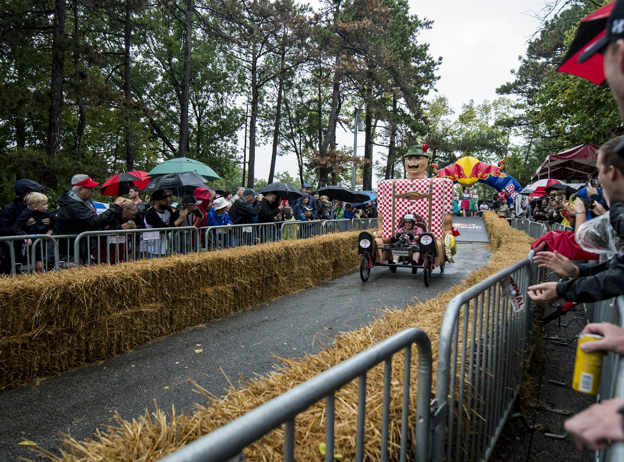 An Oktoberfest-inspired soapbox car makes its way down Martin Drive in Eden Park during the Red Bull Soapbox Derby Saturday, September 8, 2018 in Cincinnati, Ohio.