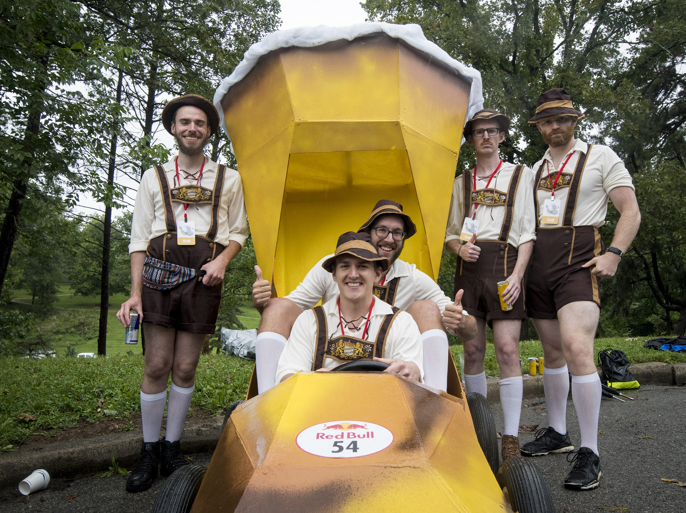 Adam Fisk and Matt Boris of Indianapolis sit in their boot-stein soapbox car with the rest of team OktoberFast before the Red Bull Soapbox Derby Saturday, September 8, 2018 in Cincinnati, Ohio.