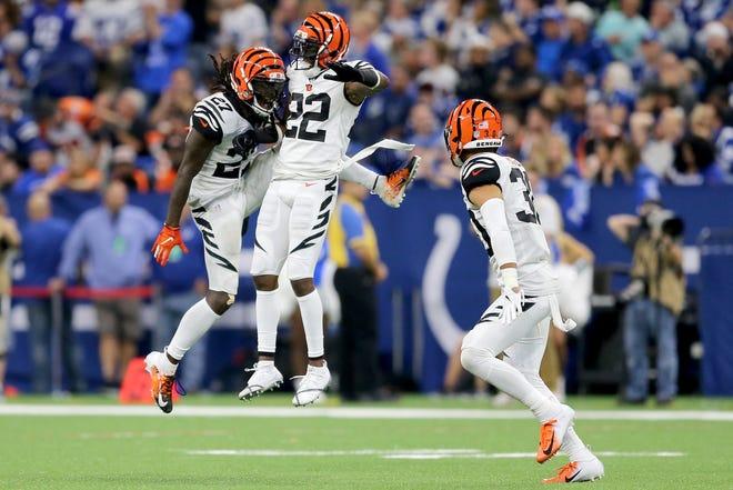 Cincinnati Bengals defensive back Dre Kirkpatrick (27), left, and Cincinnati Bengals cornerback William Jackson (22) celebrate a pass break up in the fourth quarter during the Week 1 NFL game between the Cincinnati Bengals and the Indianapolis Colts, Sunday, Sept. 9, 2018, at Lucas Oil Stadium in Indianapolis. Cincinnati won 34-23.