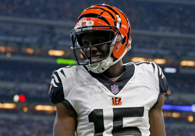 Cincinnati Bengals wide receiver John Ross (15) smiles to the TV camera after his first NFL touchdown catch in the second quarter of the NFL Week One game between the Indianapolis Colts and the Cincinnati Bengals at Lucas Oil Stadium in Indianapolis on Sunday, Sept. 9, 2018. The Colts led 16-10 at halftime.