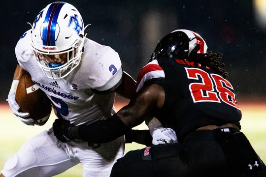 Austin Peay defensive back Juantarius Bryant (26) eyes up Presbyterian wide receiver Keith Pearson during a game last season.
