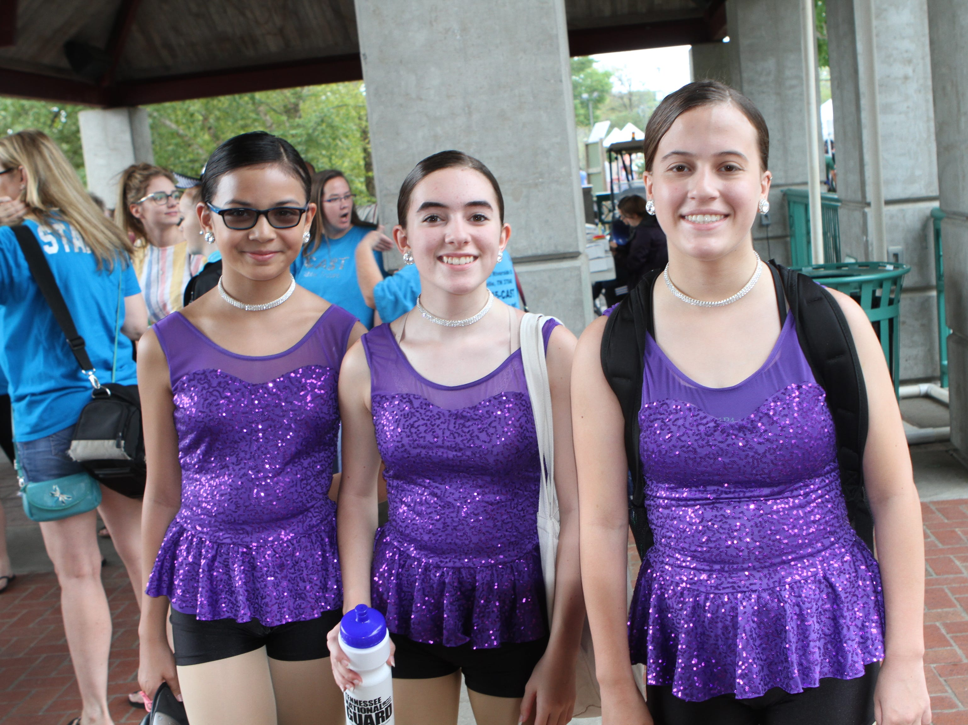 Giada Kem, Briana Howard and Gracie Logan of Lana's Dance Center get ready to perform at Clarksville Riverfest on Saturday, Sept. 8, 2018.