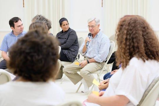 An audience member poses a question to Venerable Pasura Dantamano at the  Dhammakaya International Meditation Center in Fanwood.