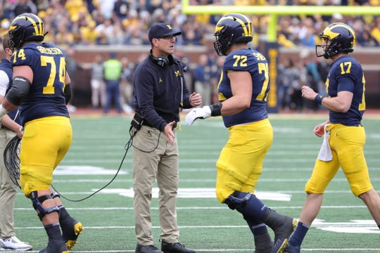Michigan head coach Jim Harbaugh congratulates his players during the first half against Western Michigan, Saturday, Sept. 8, 2018, at Michigan Stadium in Ann Arbor.