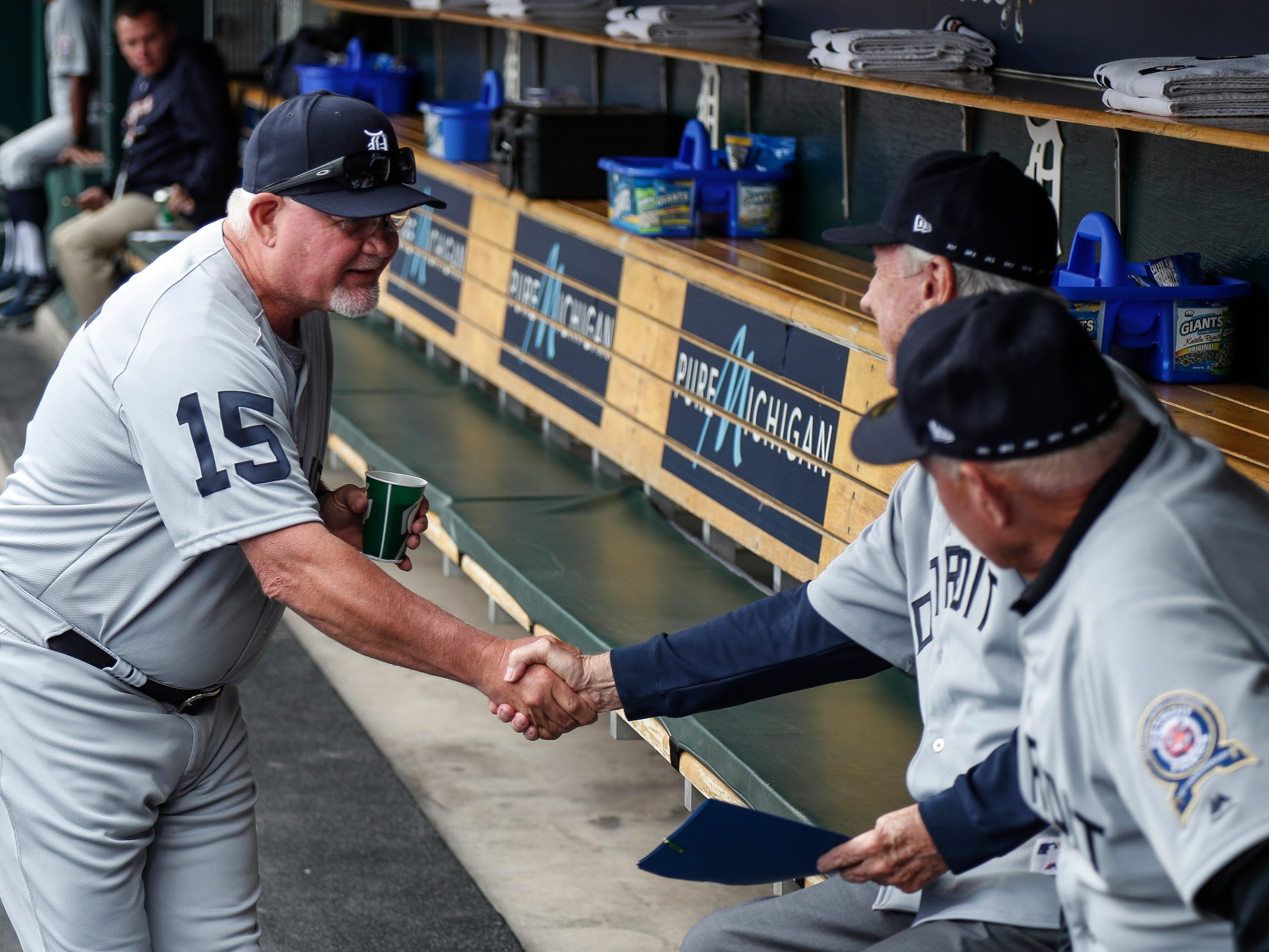 Detroit Tigers manager Ron Gardenhire shakes hands with 1968 Tigers players Al Kaline and Mickey Stanley during the celebration of the 50th anniversary of 1968 World Series championship at Comerica Park in Detroit, Saturday, Sept. 8, 2018.