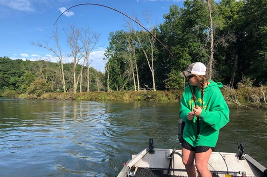 Leah Jones hooked up to a King Salmon on the Manistee River.