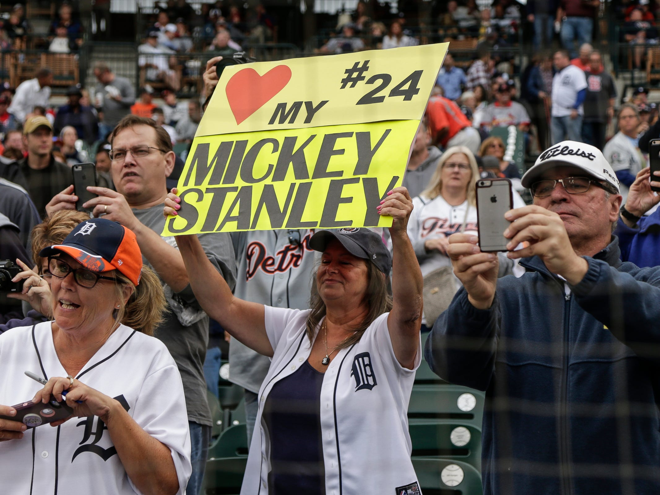 A Detroit Tigers fan holds a Mickey Stanley sign as she celebrates during the 50th anniversary of the 1968 World Series championship at Comerica Park in Detroit, Saturday, Sept. 8, 2018.