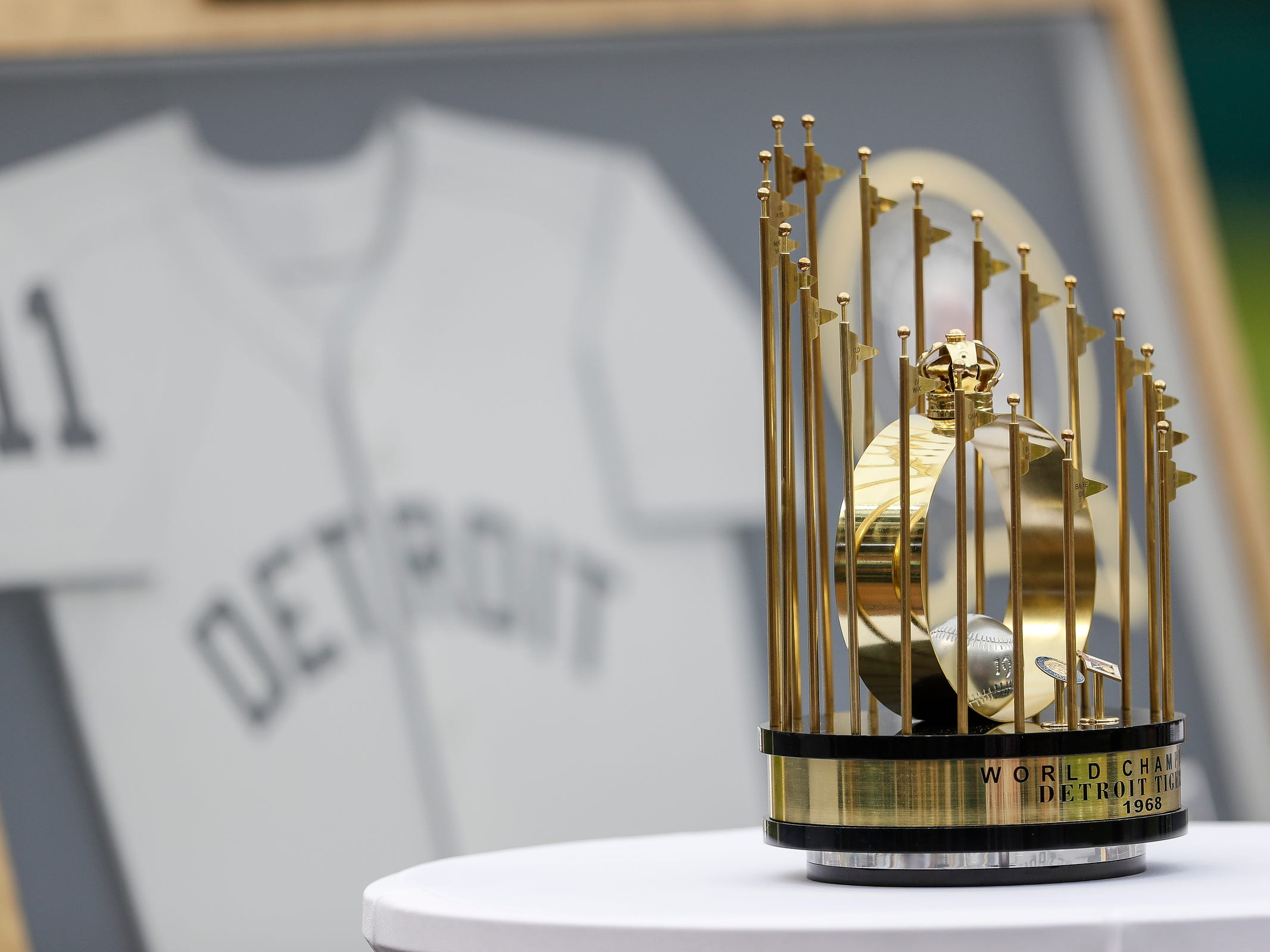 A replica of the 1968 World Series championship trophy is presented to the Detroit Tigers on the 50th anniversary of 1968 World Series championship at Comerica Park in Detroit, Saturday, Sept. 8, 2018.