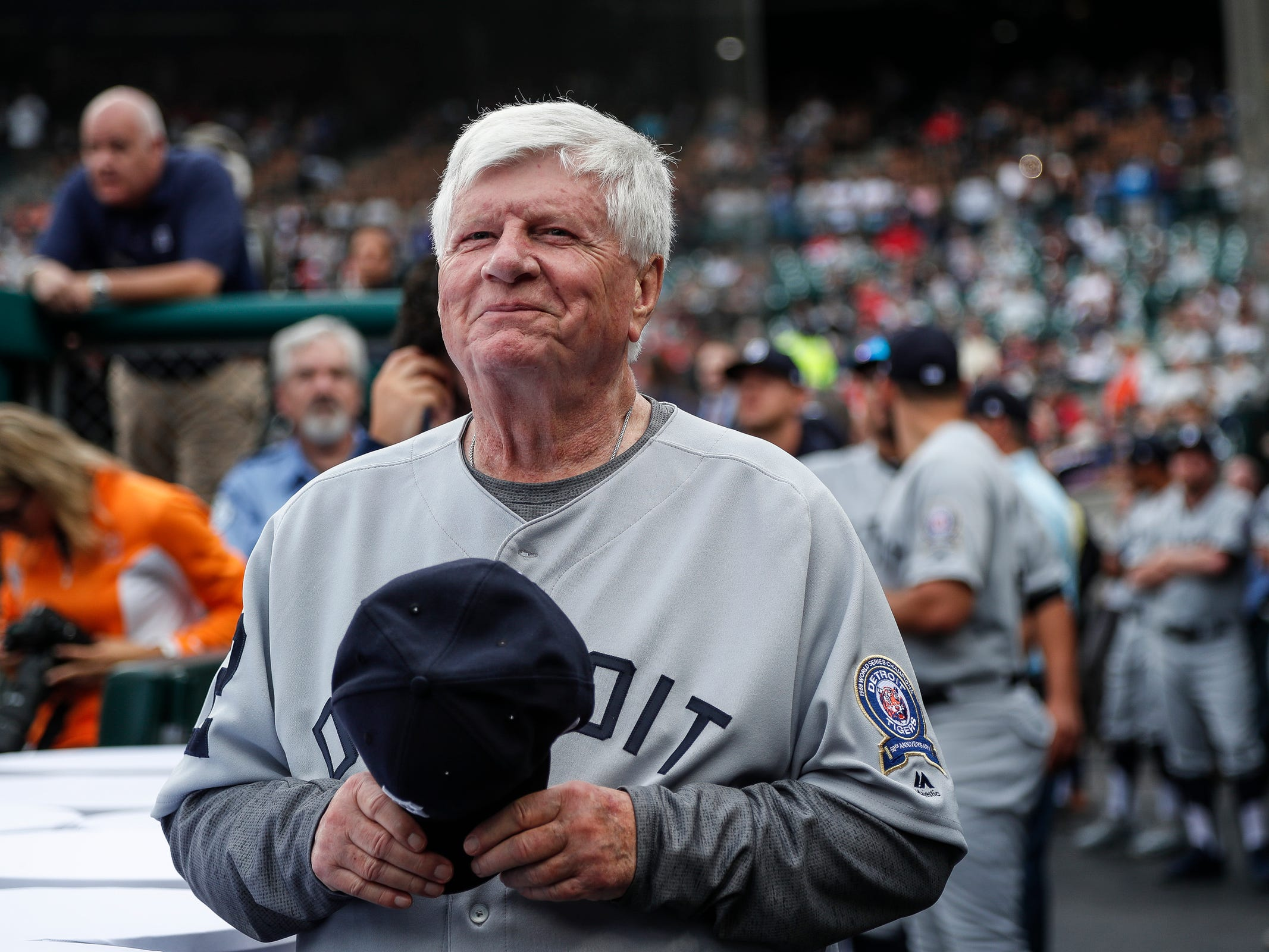Former Detroit Tigers catcher Jim Price smiles as he watches highlights from the 1968 season on the scoreboard during the celebration of the 50th anniversary of the 1968 World Series championship at Comerica Park in Detroit, Saturday, Sept. 8, 2018.