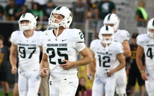 Michigan State punter Jake Hartbarger jogs onto the field to play ASU on Sept. 8, 2018, at Sun Devil Stadium.