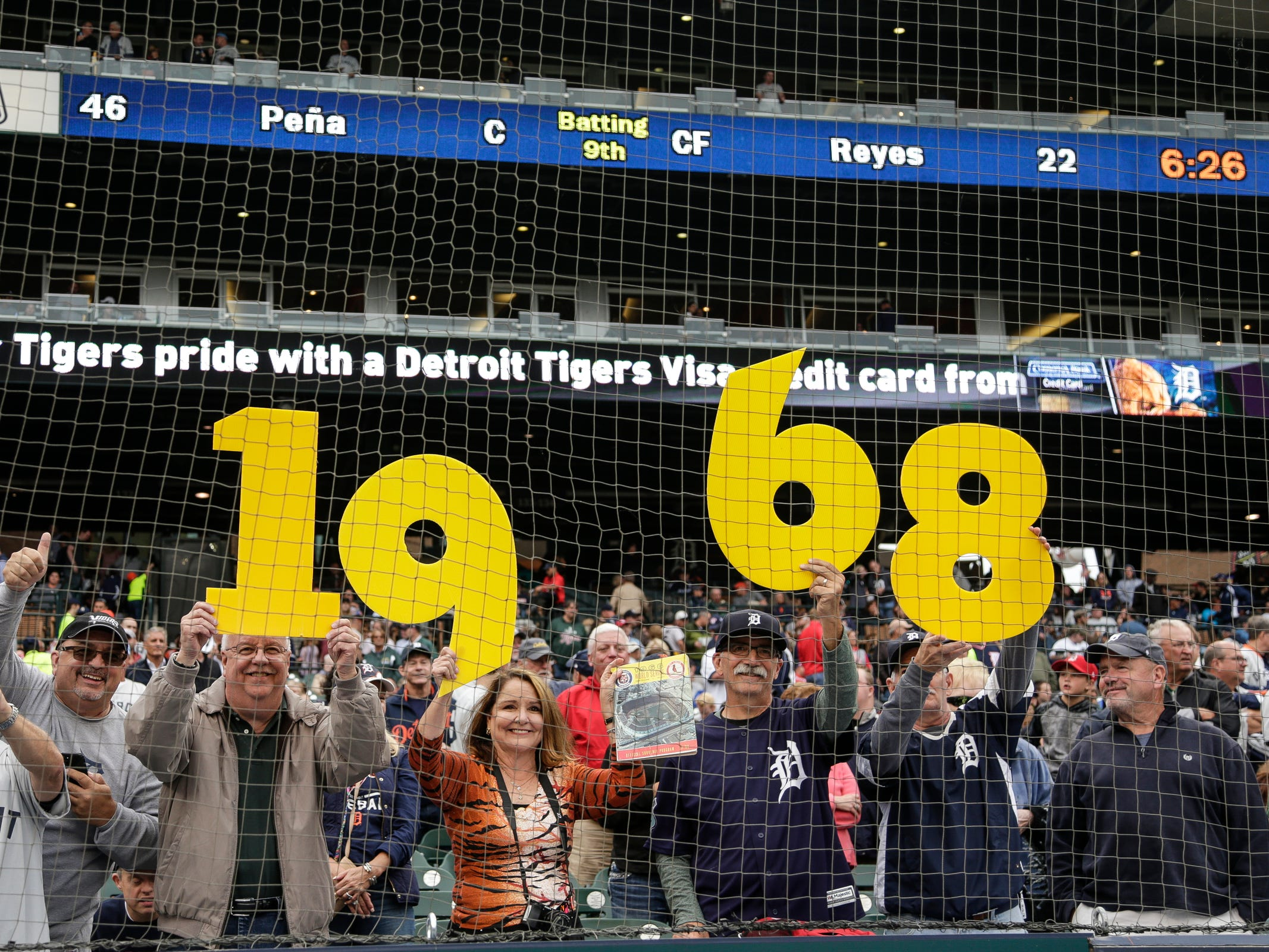 Fans hold 1968 sign as they cheer for the 1968 team during the Detroit Tigers celebration of the 50th anniversary of the 1968 World Series championship at Comerica Park in Detroit, Saturday, Sept. 8, 2018.
