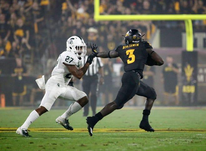 Arizona State running back Eno Benjamin runs with the ball against Michigan State safety Khari Willis on Sept. 8, 2018, at Sun Devil Stadium.