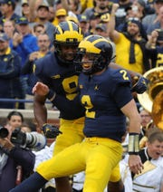Michigan quarterback Shea Patterson (2) and receiver Donovan Peoples-Jones (9) celebrate a touchdown during the second half against Western Michigan, Saturday, Sept. 8, 2018, at Michigan Stadium in Ann Arbor.