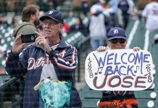 David White, of Dearborn, takes a photo as Sharon Perry, also of Dearborn, holds a sign to welcome back Jose Feliciano during the Detroit Tigers celebration of the 50th anniversary of the 1968 World Series championship at Comerica Park in Detroit, Saturday, Sept. 8, 2018.