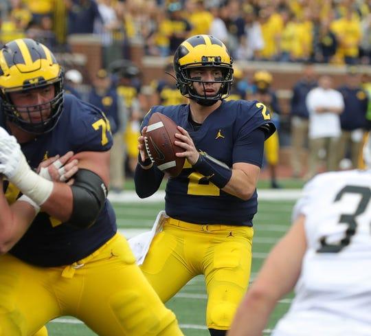Michigan quarterback Shea Patterson looks to pass against Western Michigan, Saturday, Sept. 8, 2018, at Michigan Stadium in Ann Arbor.