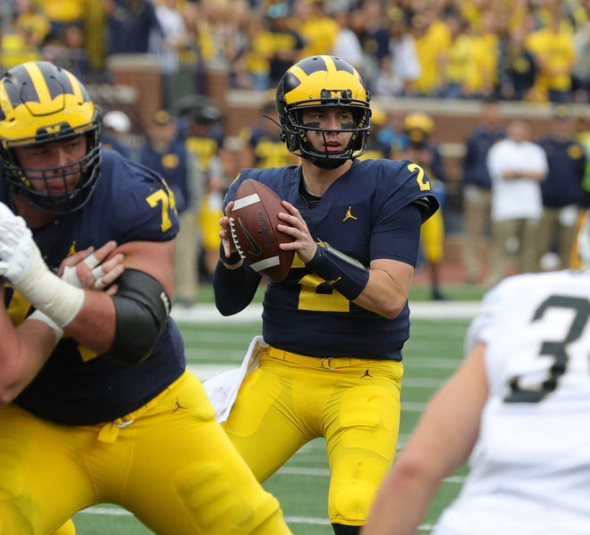 Michigan quarterback Shea Patterson looks to pass against Western Michigan, Saturday, Sept. 8, 2018, at Michigan Stadium in Ann Arbor.