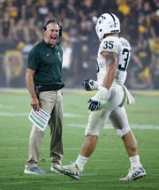 Michigan State head coach Mark Dantonio yells at linebacker Joe Bachie during the game against Arizona State in the first half Sept. 8, 2018, at Sun Devil Stadium.