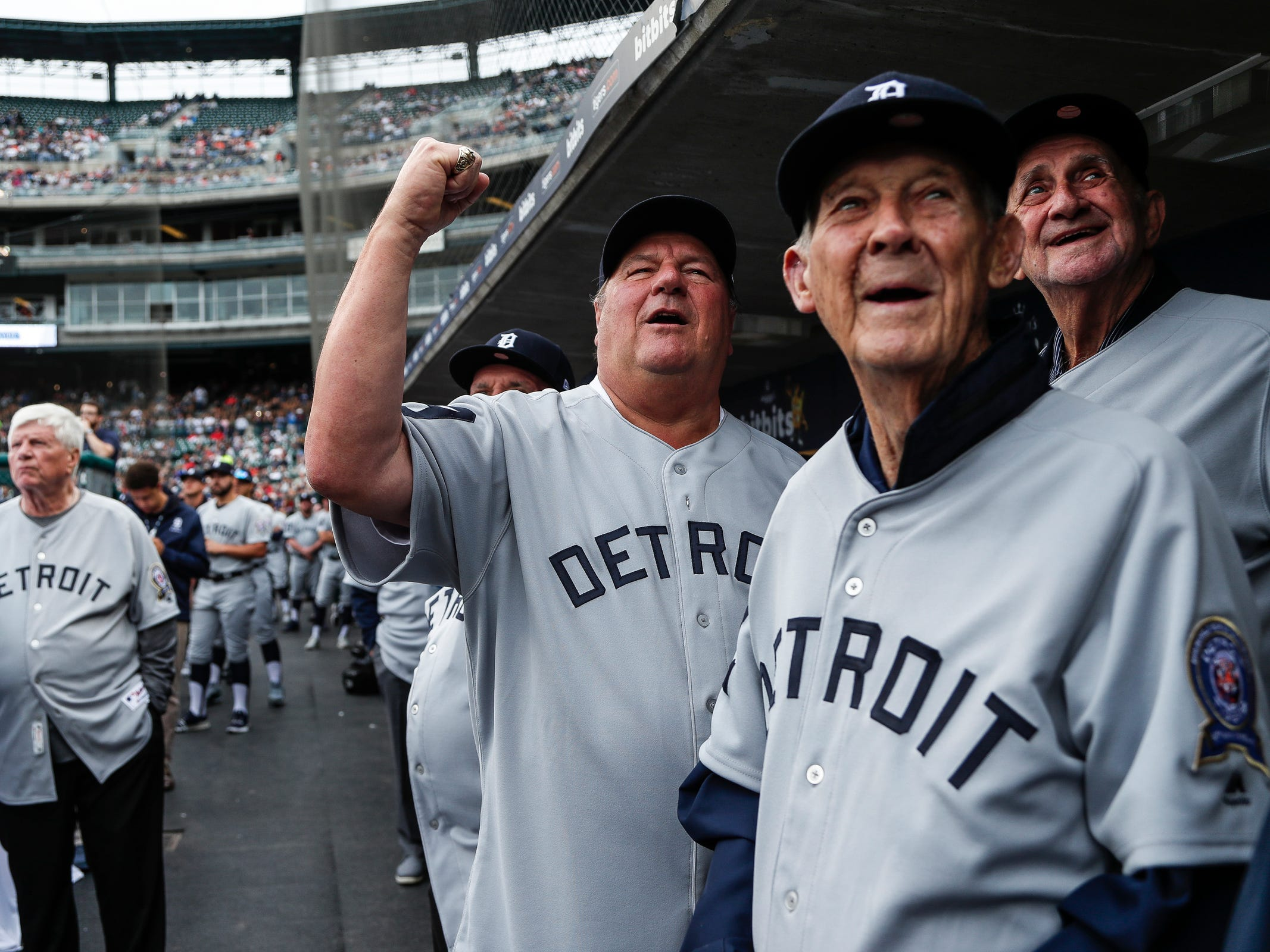 Former Detroit Tigers' Jon Warden, center, coach Hal Naragon, third base Don Wert, far right, cheer as they watch highlights from the 1968 season during the celebration of the 50th anniversary of the 1968 World Series championship at Comerica Park in Detroit, Saturday, Sept. 8, 2018.