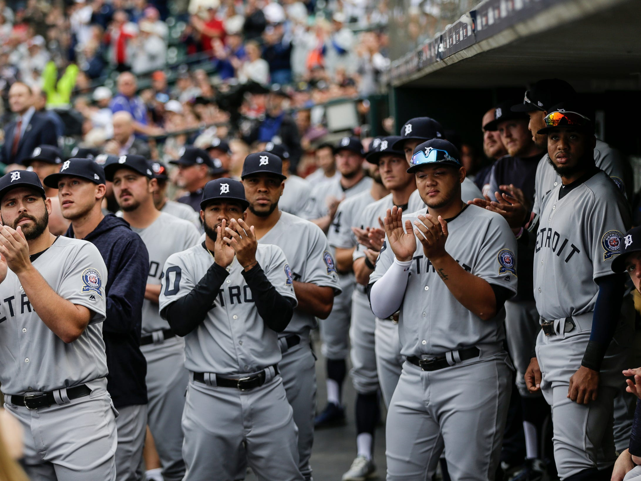 Current Detroit Tigers players clap as they watch 14 members of the 1968 World Series championship team be honored during the celebration of the 50th anniversary of the 1968 World Series championship at Comerica Park in Detroit, Saturday, Sept. 8, 2018.