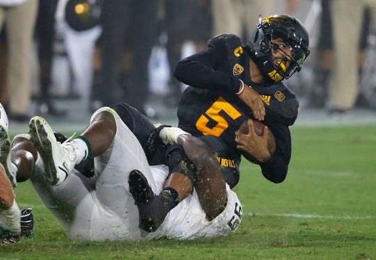 Arizona State quarterback Manny Wilkins is tackled by Michigan State defensive tackle Raequan Williams during the first half Saturday, Sept. 8, 2018, in Tempe, Ariz.