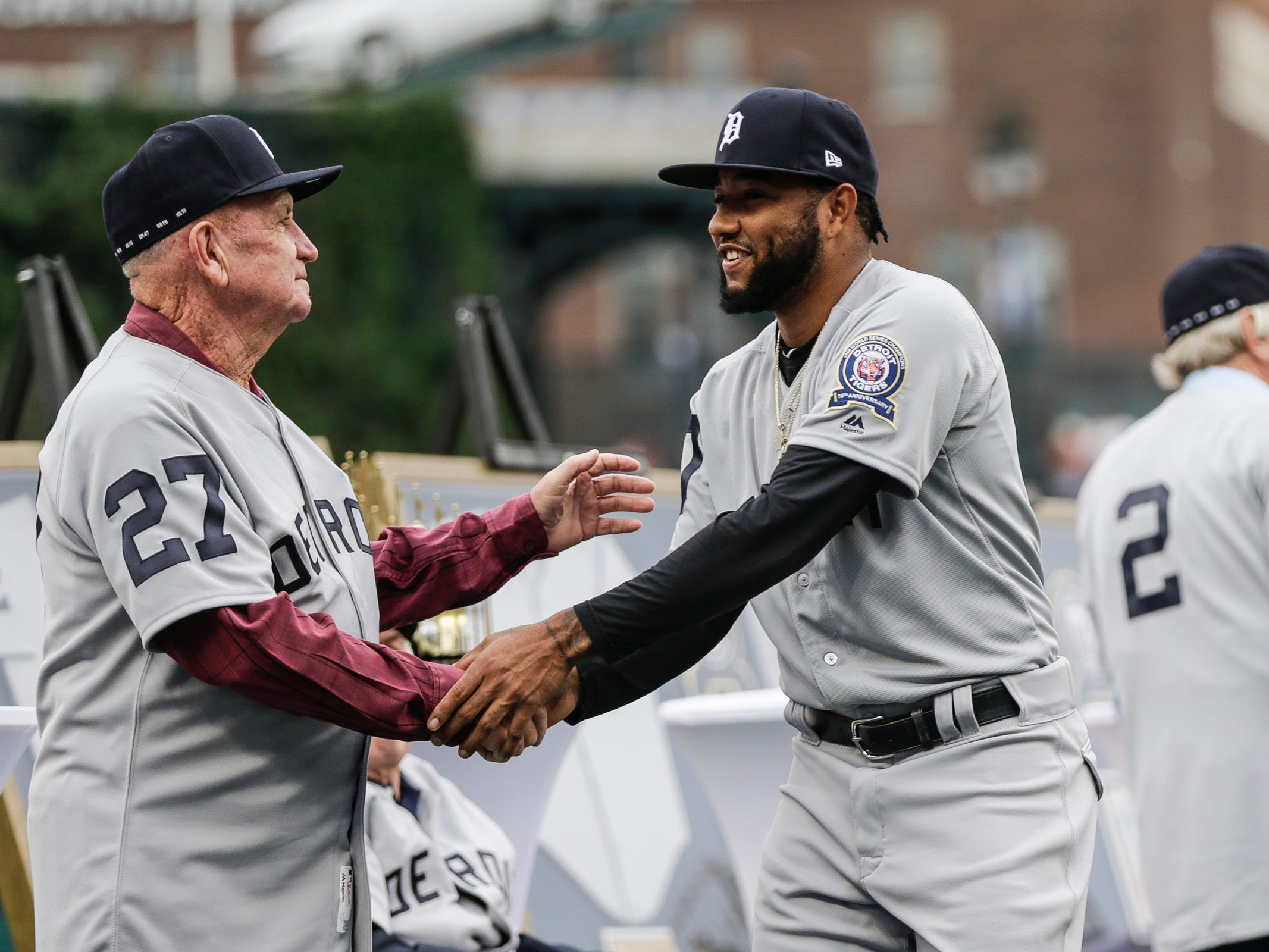 Detroit Tigers infielder Ronny Rodriguez (60), right, shakes hands with former Tigers outfielder Wayne Comer (27) during Detroit Tigers celebration of the 50th anniversary of 1968 World Series championship at Comerica Park in Detroit, Saturday, Sept. 8, 2018.
