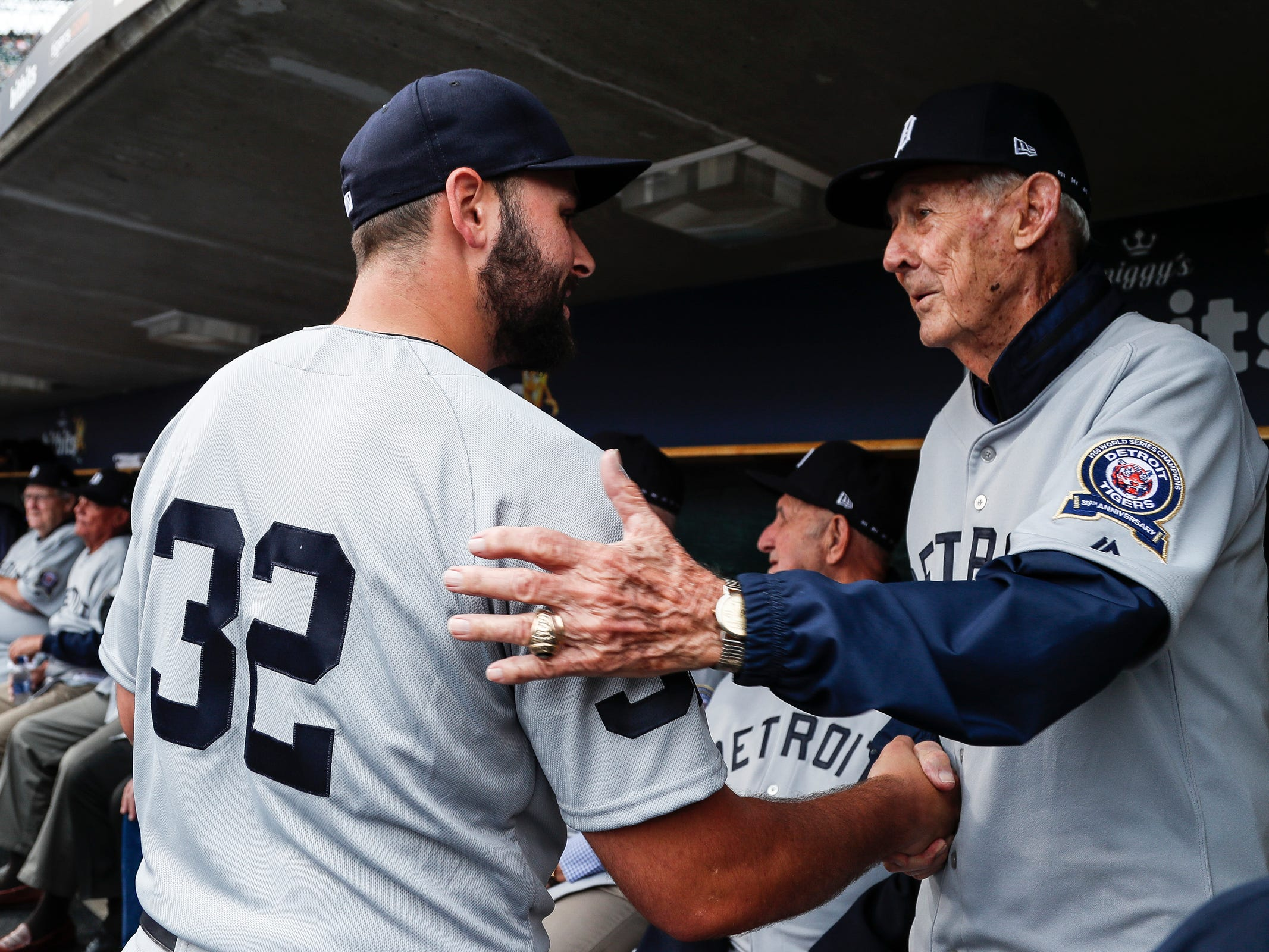 Detroit Tigers pitcher Michael Fulmer shakes hands with former Tigers coach Hal Naragon during the celebration of the 50th anniversary of the 1968 World Series championship at Comerica Park in Detroit, Saturday, Sept. 8, 2018.