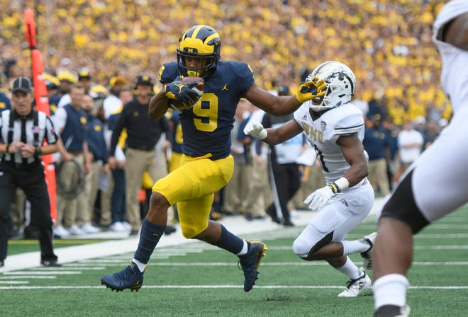 Donovan Peoples-Jones hauled in one of Shea Patterson's three passing touchdowns on Saturday against Western Michigan.