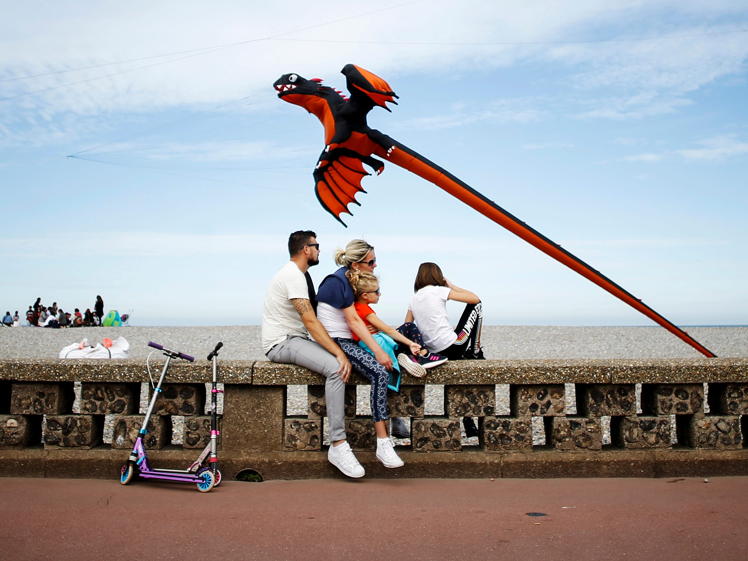 People look at kites during the 20th edition of the International Dieppe Kite Festival on September 9, 2018, in Dieppe, northwestern France. The event, held until September 16, gathers thousand of people from 34 different countries.