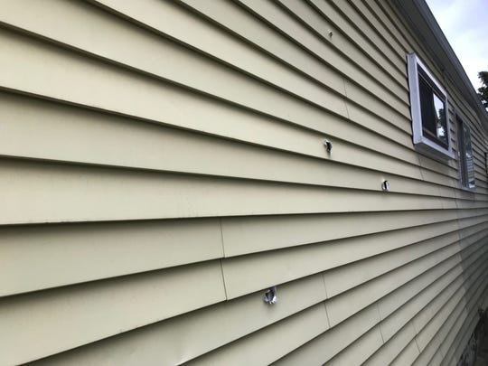 Bullet holes on the exterior of the house in the  3300 block of South Annabelle in southwest Detroit.