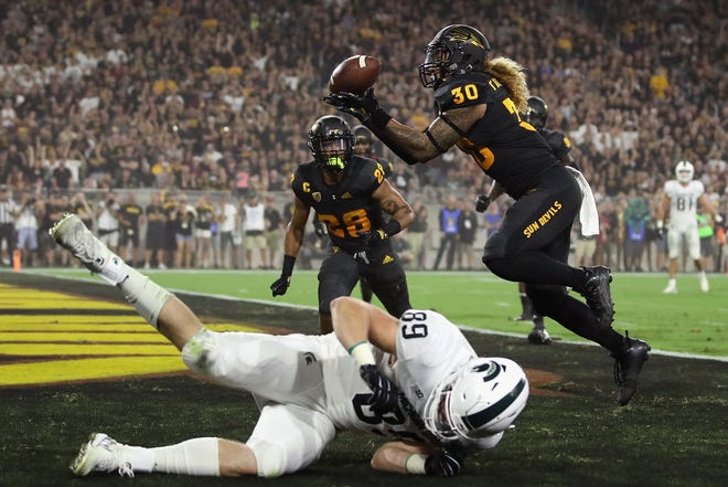 Arizona State defensive back Dasmond Tautalatasi intercepts a pass intended for Michigan State tight end Matt Dotson during the first half on Saturday.