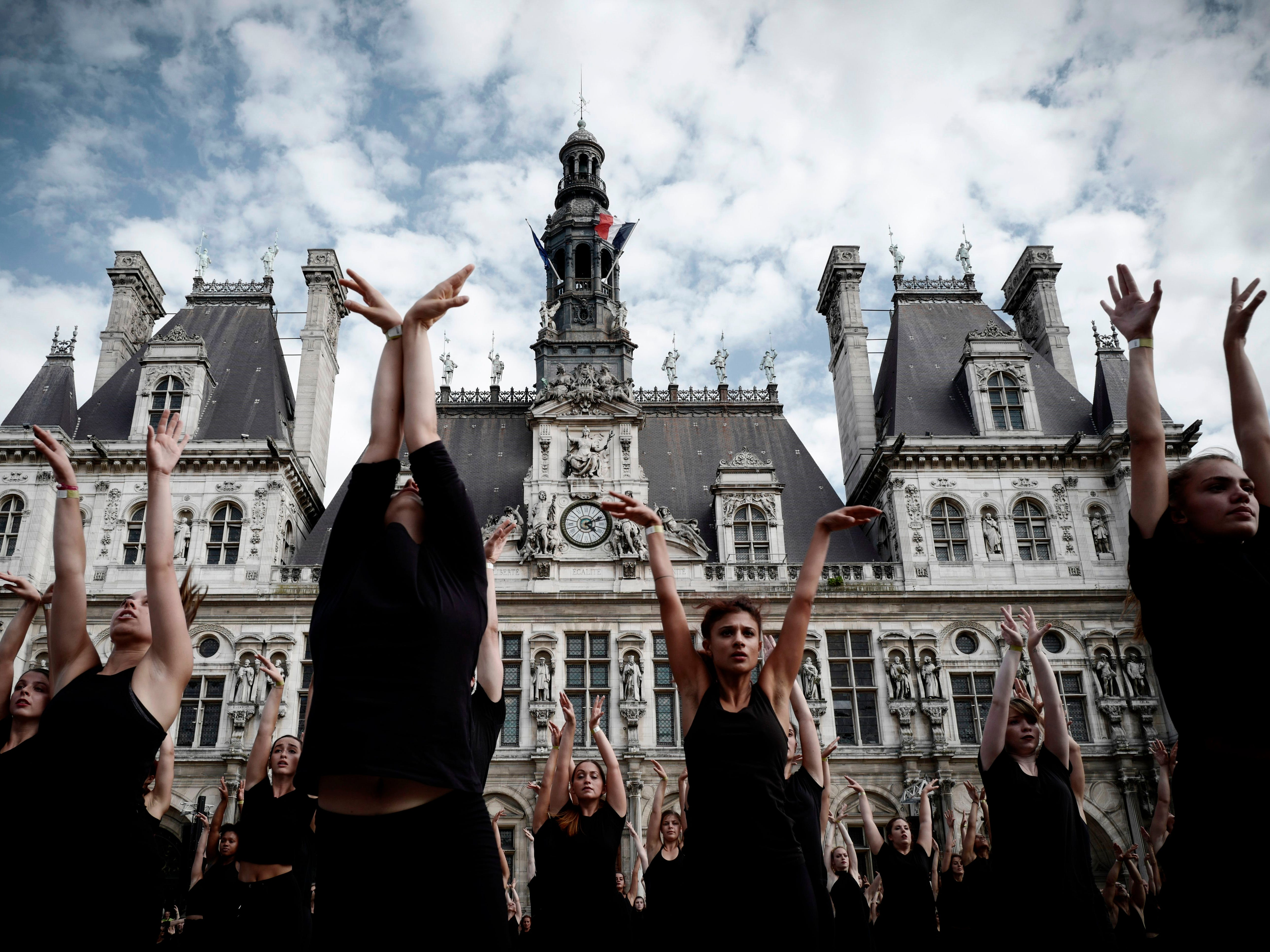"Dancers perform for an outdoor mass performance created by choreographer Akram Khan titled ""Kadamati"" in front of the city hall in Paris on September 9, 2018."