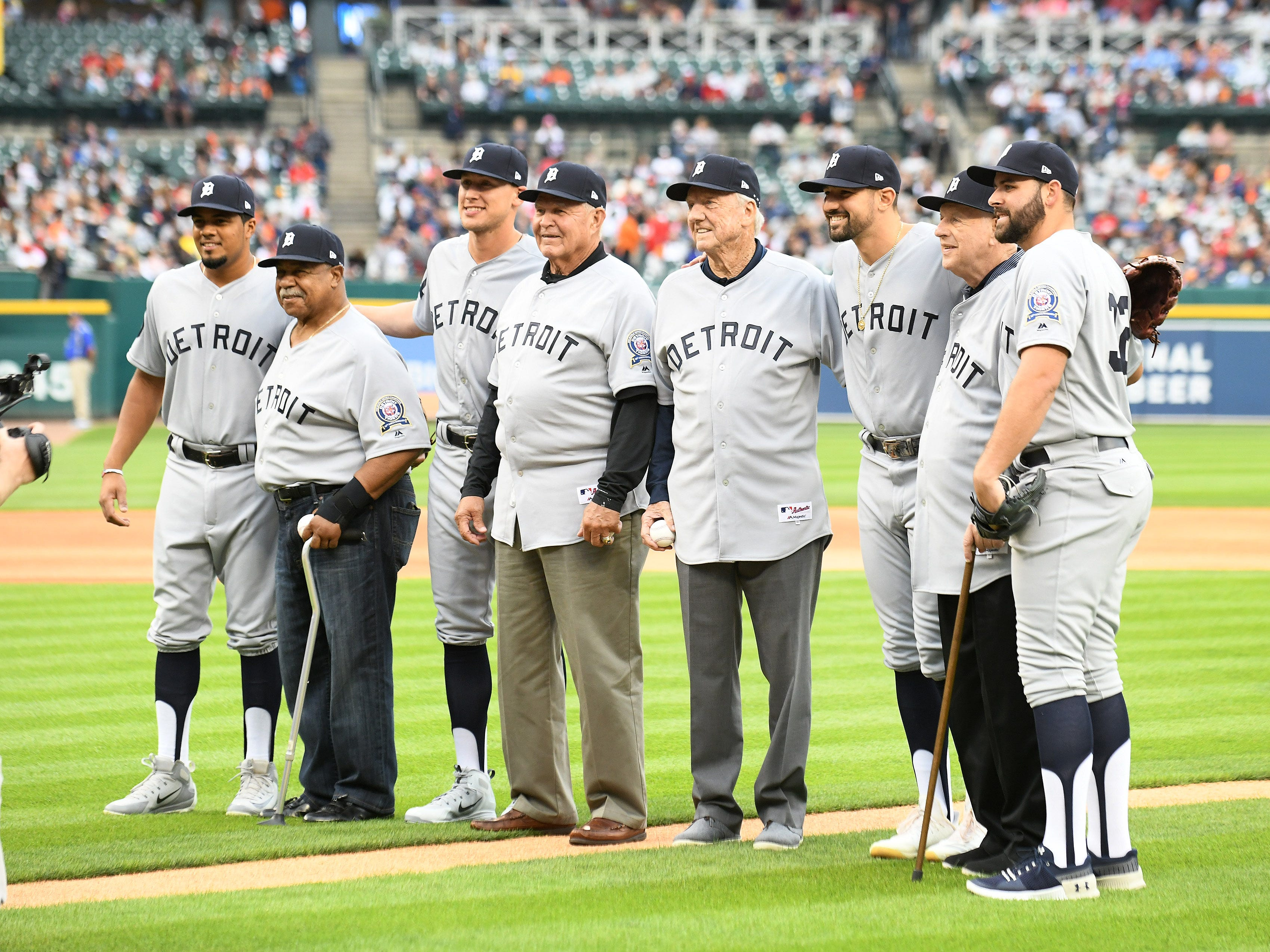 From left, Jeimer Candelario, Willie Horton, JaCoby Jones, Mickey Stanley, Al Kaline, Nicholas Castellanos, Mickey Lolich and Michael Fulmer after the ceremonial first pitch.