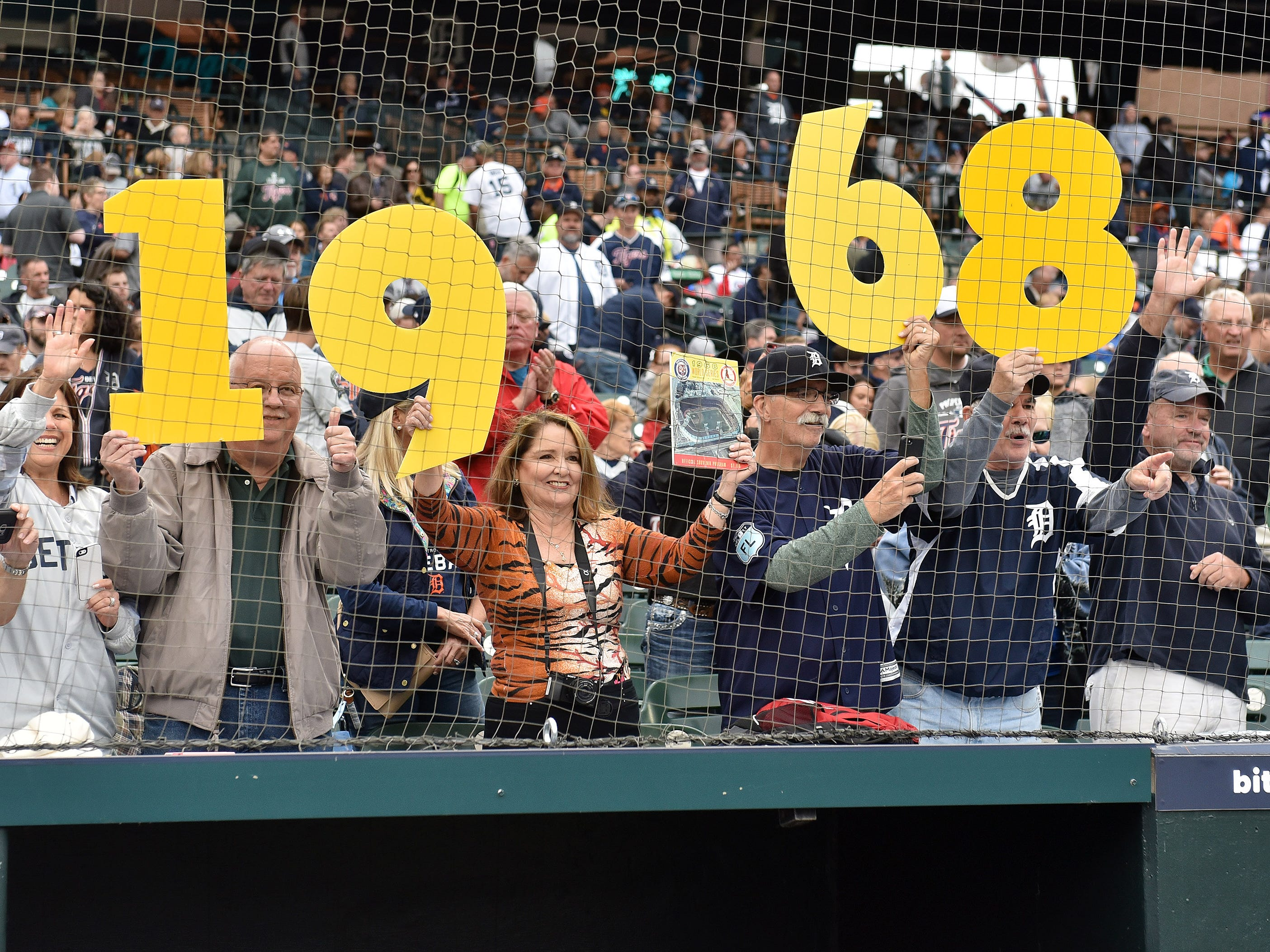 Fans hold up the numbers 1968 at the end of the ceremony