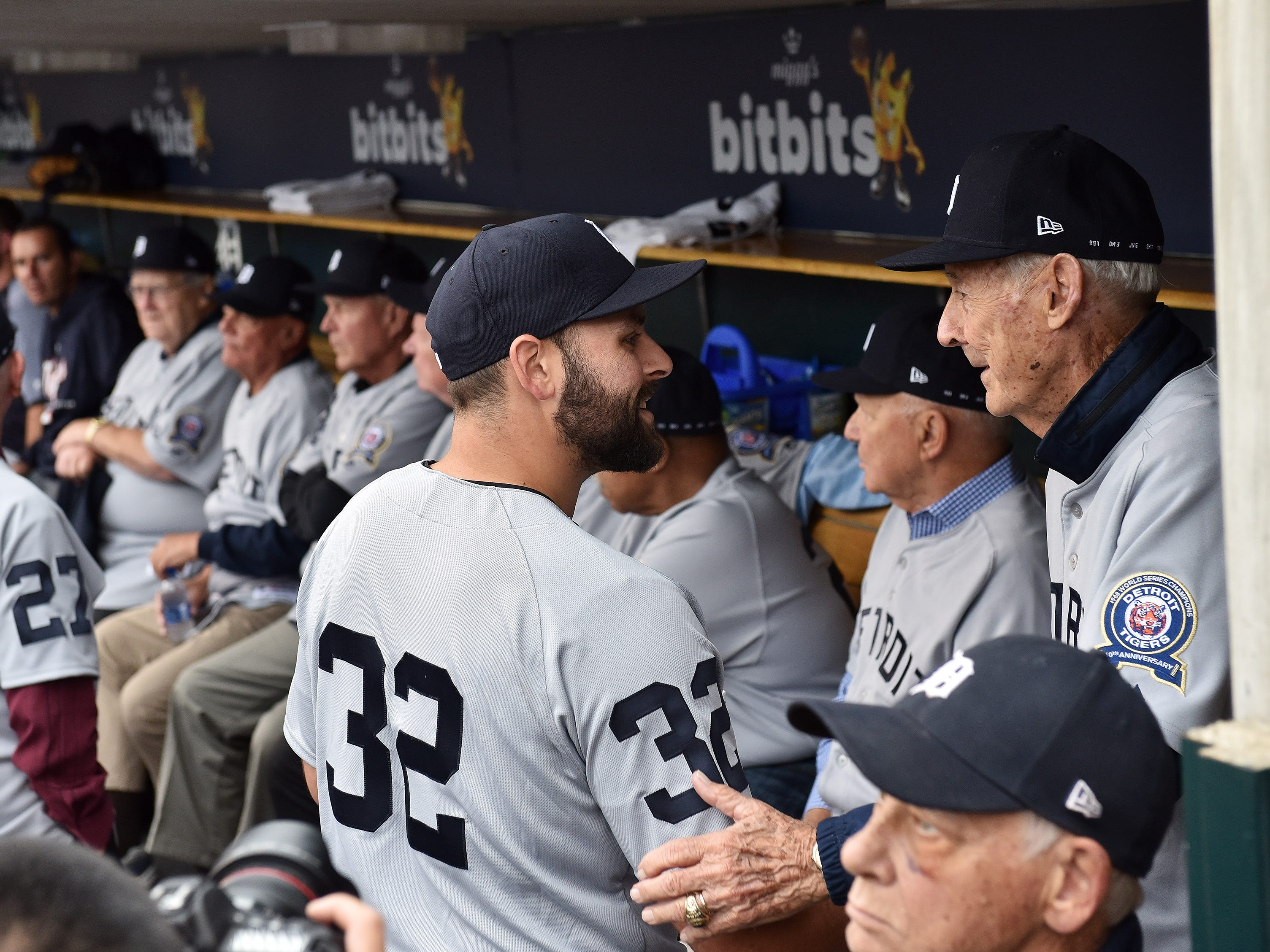Tigers pitcher Michael Fulmer talks with Hal Naragon, right, bullpen coach from the 1968 Tigers, during the ceremony.
