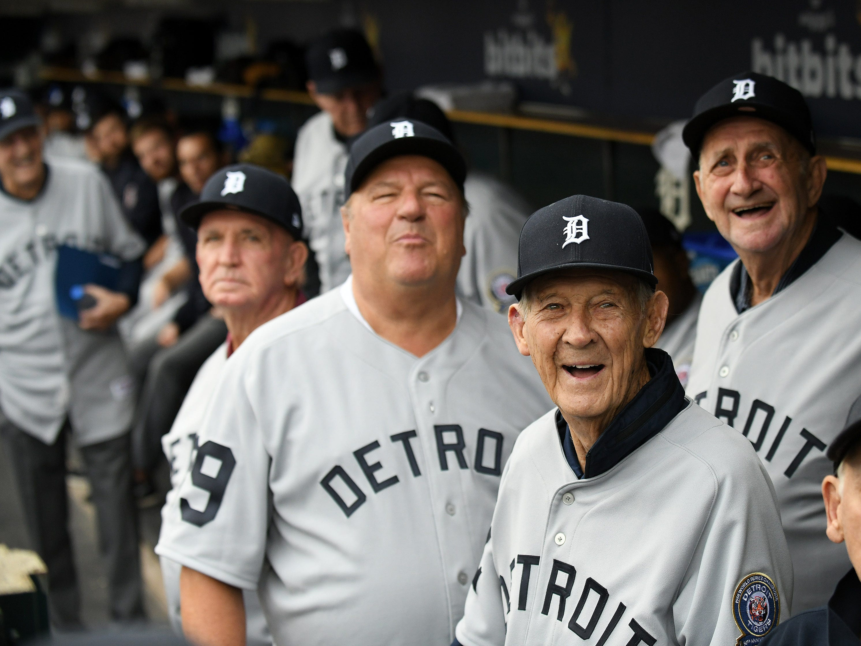 From left, Jon Warden, Hal Naragon and Don Wert, members of the 1968 Tigers, watch a video montage during a pregame ceremony.