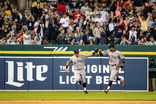 Mikie Mahtook, left, celebrates with Victor Reyes after making a leaping catch to rob a home run in the fifth inning during the Tigers' 4-3 victory over the Cardinals on Saturday.