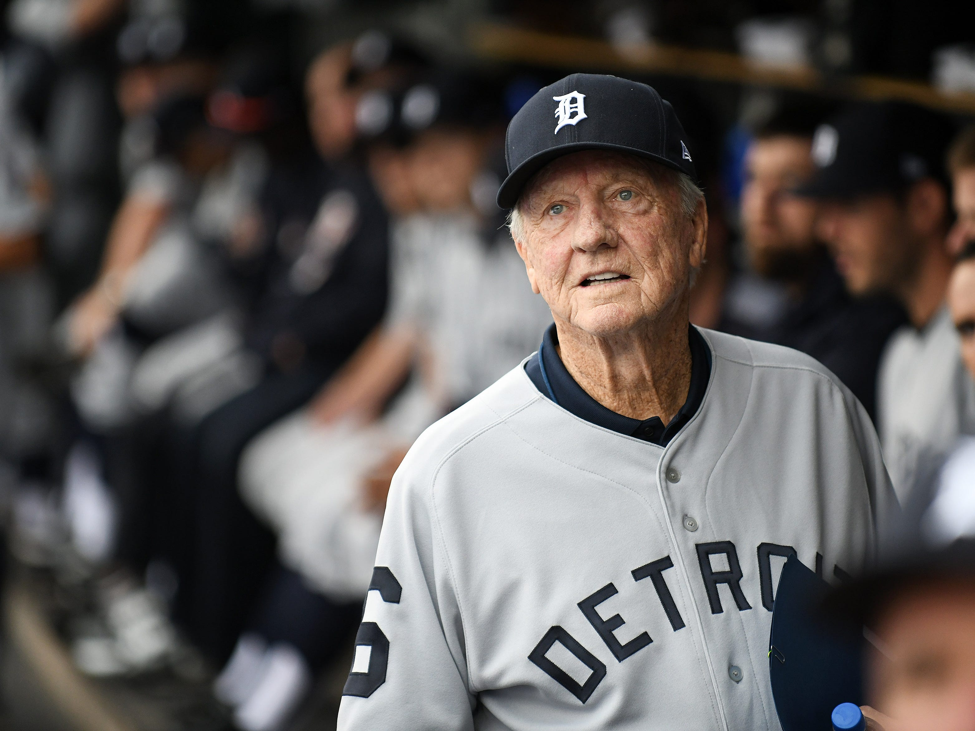 Al Kaline, Hall of Famer and member of the 1968 Tigers, watches as a video is played on the scoreboard.