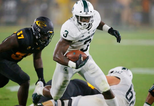 Michigan State running back LJ Scott runs past Arizona State linebacker Darien Butler earlier this season.