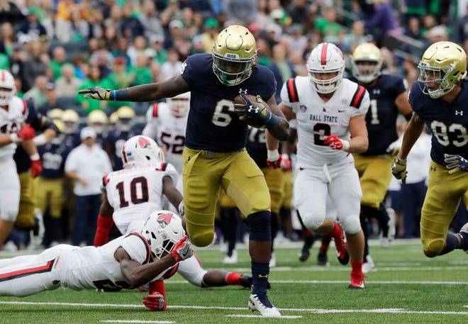 Saturday S Top 25 Football No 8 Notre Dame Fends Off Ball State