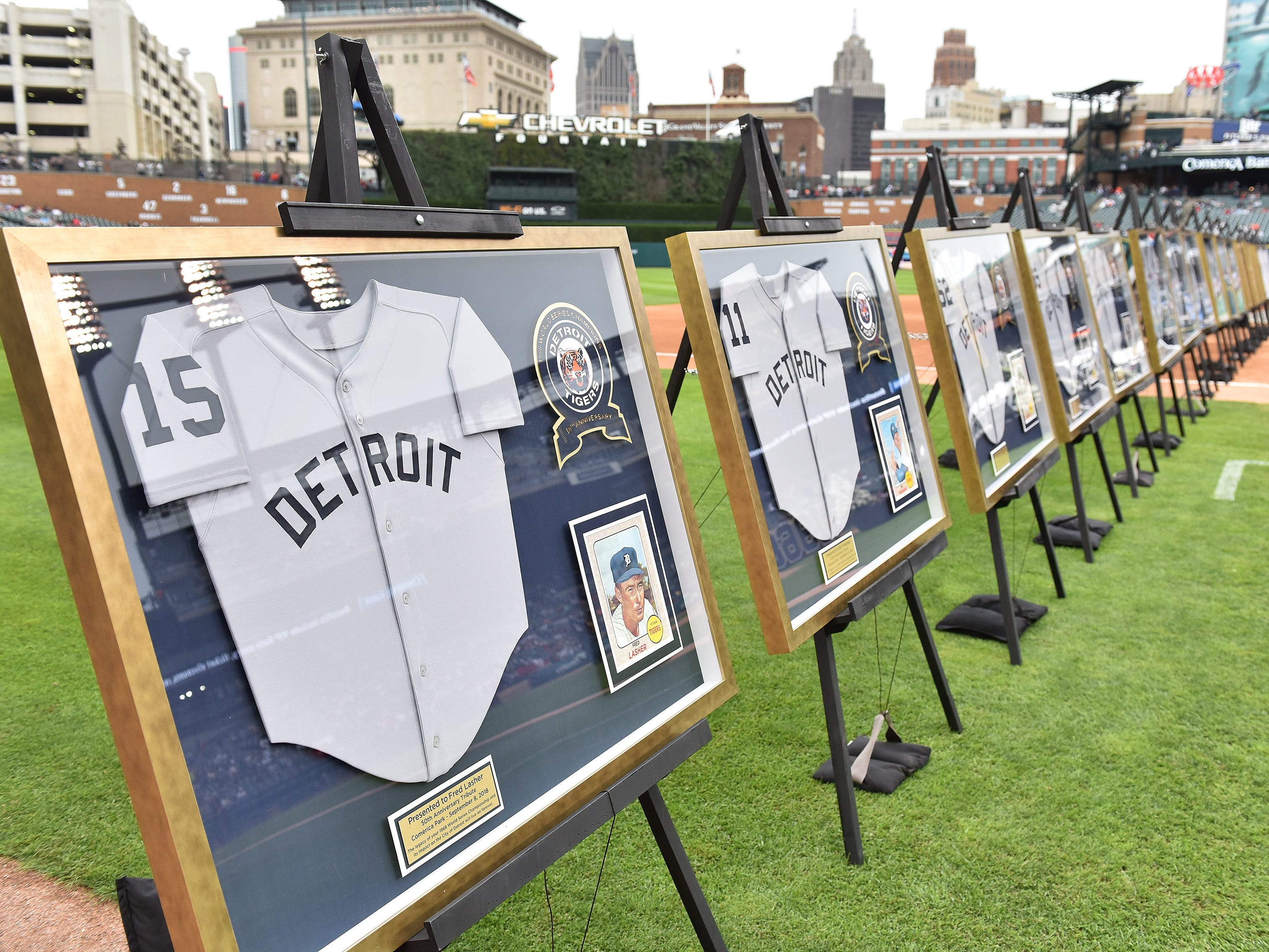 Framed jerseys with a photo, anniversary log and plaque for each of the players being honored.
