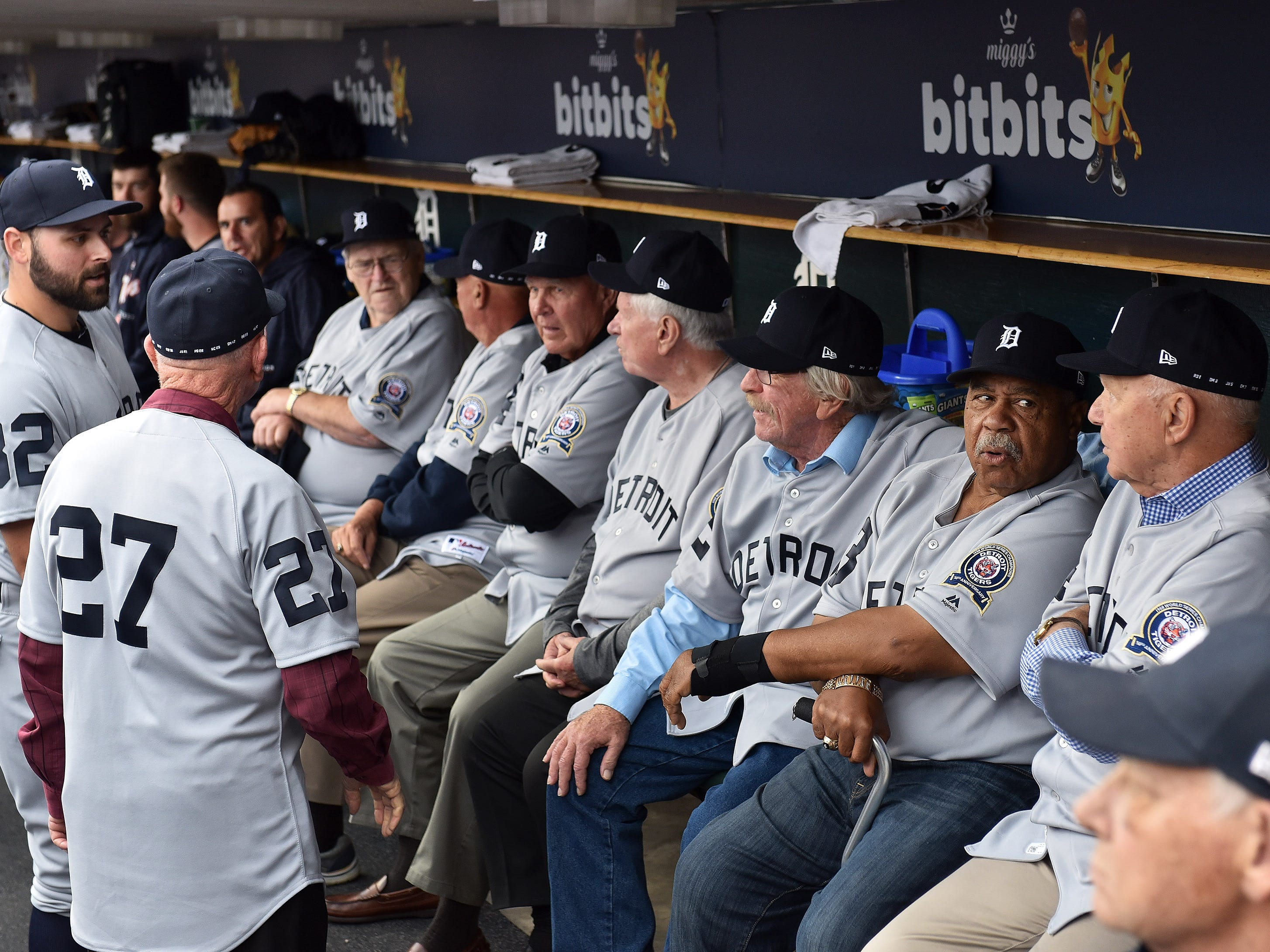 Tigers pitcher Michael Fulmer (32) talks with members of the 1968 Tigers during a pre-game ceremony.