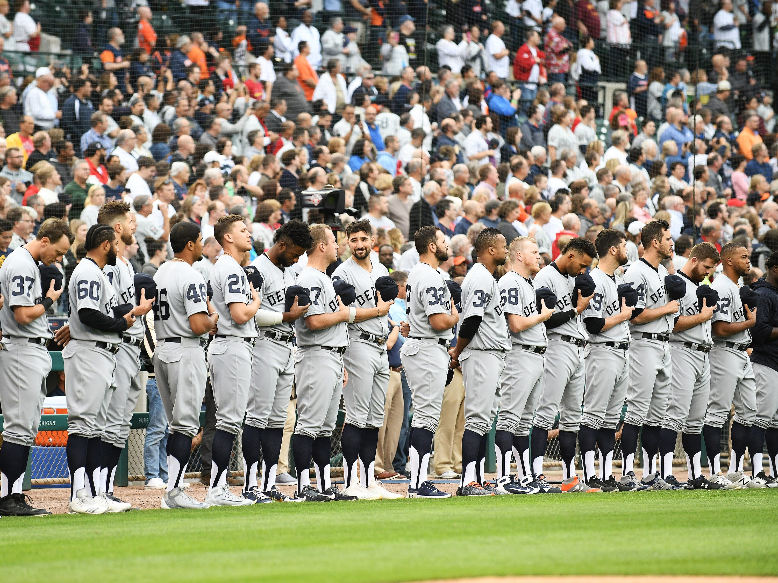 Tigers stand during the national anthem.